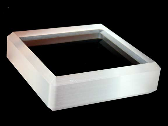 Fused Silica Window with beveled edge.