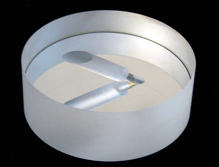 Aluminum-coated mirror with thru-hole that has a 45 degree counter-bore.